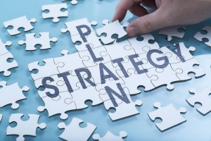 A jigsaw of the words Plan and Strategy